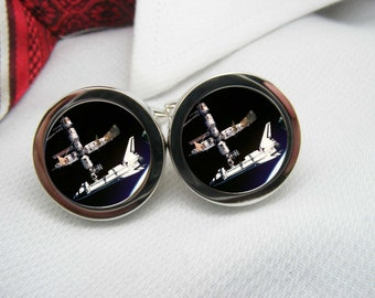 Space Shuttle docked to space station in space cufflinks   NOV-SPA0007