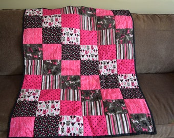 A profusion of PINK PUPPIES! A baby quilt for the modern baby. Pink, black, white and gray puppies, polka dots and stripes. 36 X 45 in.