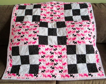 Pink and black Scotty Dog Quilt. A cute patchwork baby quilt using 9 patch blocks with black and white, the first colors baby sees!