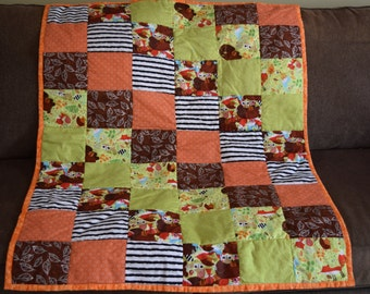 Cute woodland animals. Fall colors for a fall baby!  Cute woodland animals.  Soft puffy quilt for baby or toddler.36 X 45 in.