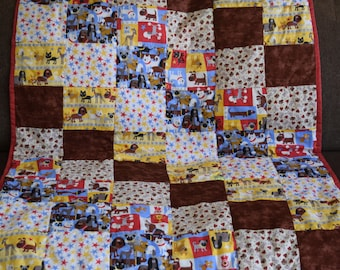 Plenty of Puppies!  Cute puppy quilt for a baby or toddler.  Soft and puffy.  Bright colors of red, blue, yellow, brown. 36 X 45 in.