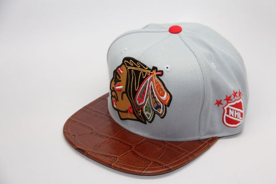 73094c63894 Items similar to Custom Snapback Mitchell   Ness Alligator Crocodile Skin  Chicago Blackhawks Strapback Double Sided Crocodile Skin Don C on Etsy
