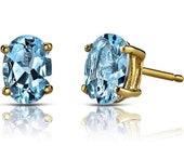 Oval cut Blue topaz 5a grade cubic zirconia .925 sterling silver stud earrings