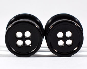 Plugs made of buttons single piece