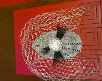 Silver and black fascinator