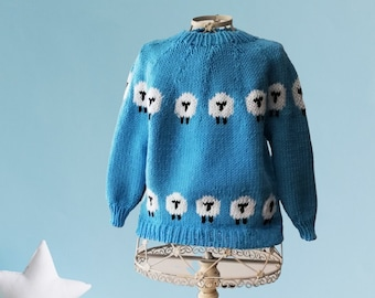 knit sweater for child in merino wool, with round joke and happy sheep circle. Made to order