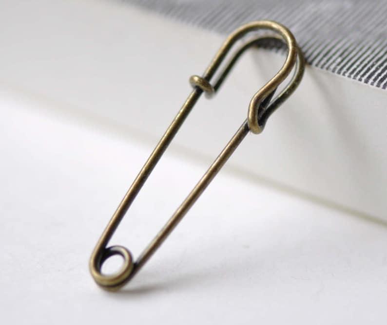 dcaec660273b6 10 pcs Antique Bronze Kilt Pin Safety Pins Brooch 10x60mm A7640