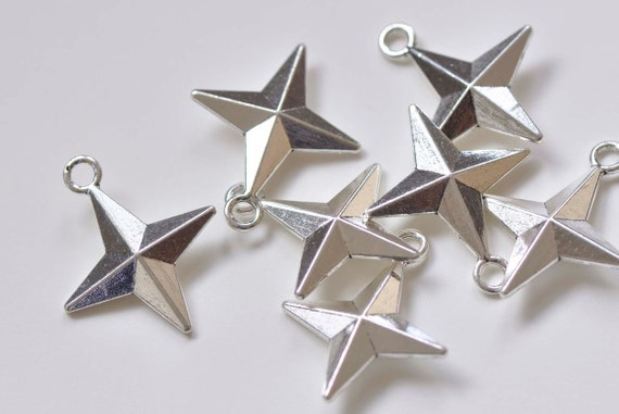 Star 25 charms in antique silver. . ref:3676