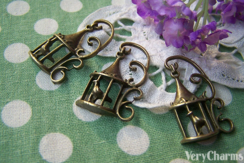 10 pcs of Antique Bronze Filigree Bird Cage Charms 20x34mm A2851