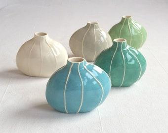 Small ceramic vase. Colorful round bud vase