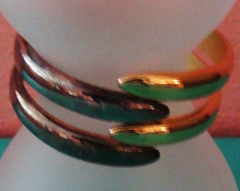 Gold tone and silver tone clamper bracelet