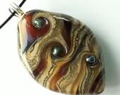 Molasses swirls! Beautiful glass necklace made Jenefer Ham