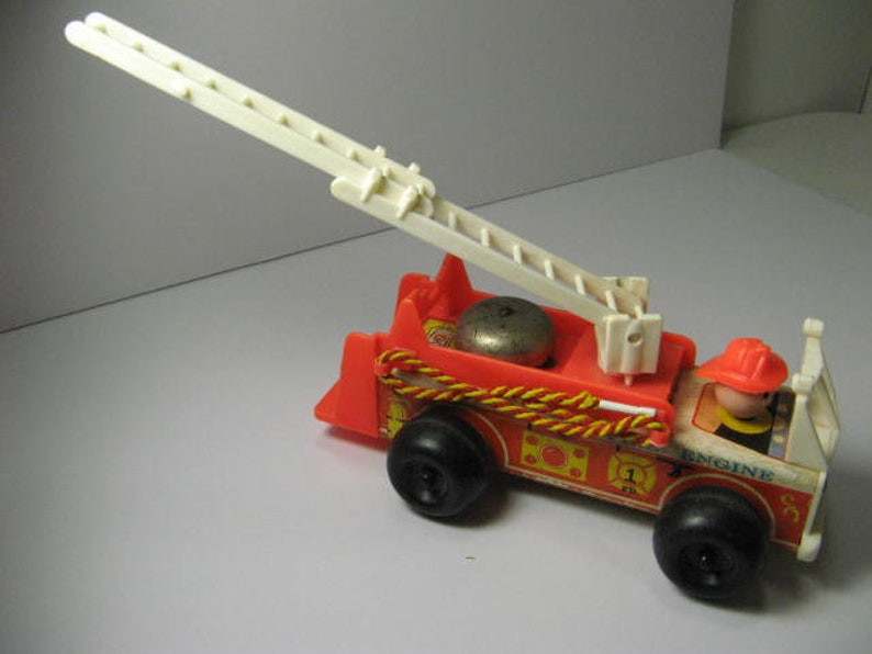 Fisher Price Fire Truck, 1970's, Extension ladder and Fireman  Driver is  attached to truck  The ladder extends