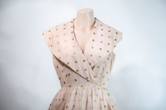 1950s pastel pink party dress with gold polka dots