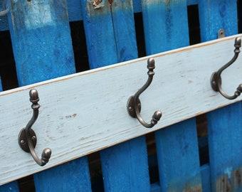 Sturdy cast iron three hook coat rail. Distressed grey paint on reclaimed timber.