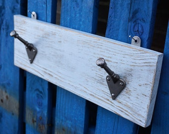 Distressed paint, 2 hook coat rack. Light grey painted board with 2 arts and crafts style hooks.