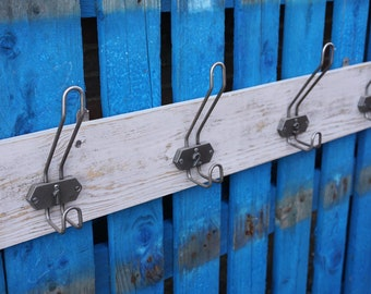 Sturdy set of 4 numbered school coat hooks mounted on distressed grey painted reclaimed timber.
