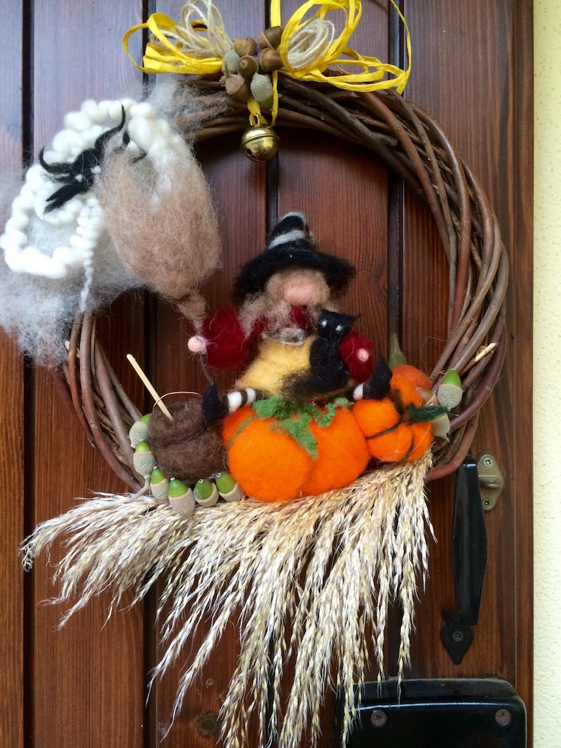 with Witch Halloween natural elements and a bell black cat spider in carded fairy wool Wreath  Garland to hang on the door Waldorf