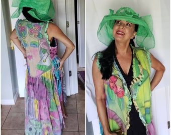 Long creative one of a kind wearable art coat sleeveless vest style. Floral whymsical flowing statement piece