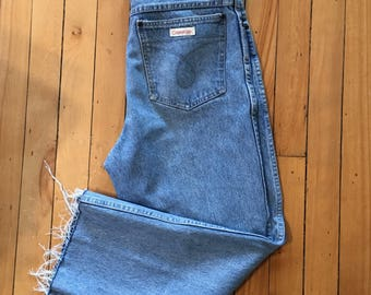 cd338bb0ec0d VTG Calvin Klein Jeans. 70s Women s High Waisted Denim Jeans. Cropped and  Frayed Hem Vintage Jeans.