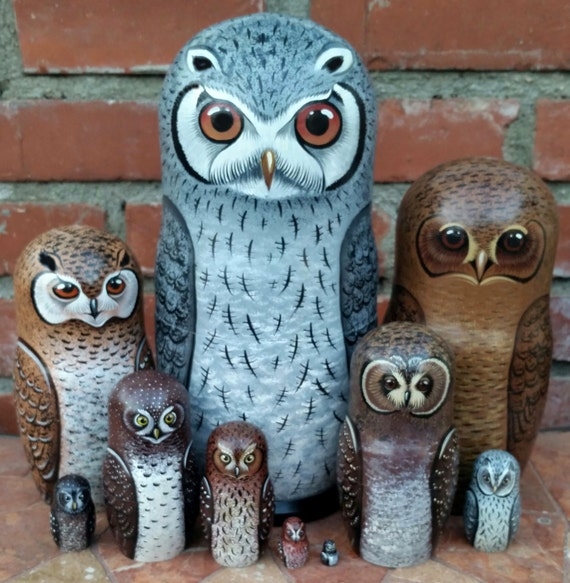 Owls of Africa on the Set of Ten Russian Nesting Dolls. White Faced.