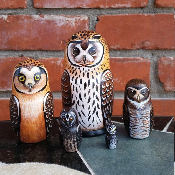 Owls of South America on the Set of Five Russian Nesting Dolls. Small.