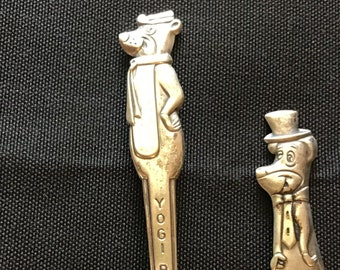 Pair of character spoons Yogi Bear and Huckleberry Hound