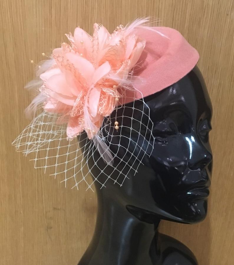 851b4416f94f0 Caprilite Peach Pink Fascinator Hat Pill Box Flower White Veil   Etsy