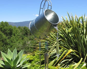 Pressed tin watering can windchime