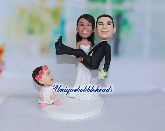 family wedding cake toppers uk family wedding cake topper figurines holding 14186
