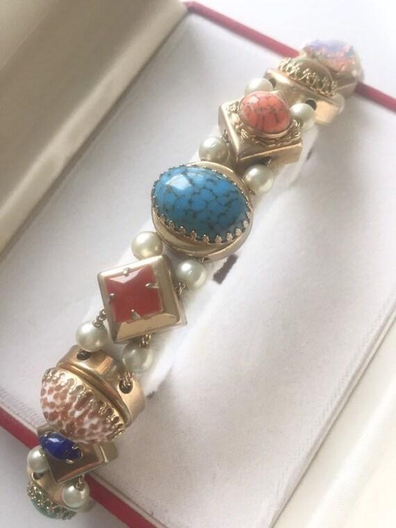 SLIDE ANTIQUE BRACELET Antique Slide Bracelet.1940
