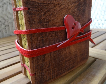 Small leather journal, brown, tea stained paper, with a heart button