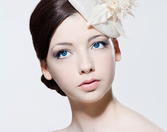 Sinamay headpiece with silk dupion flower spray perfect for a wedding or the races.