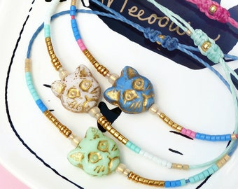 96b9c78634b9 Macrame friendship bracelets with pastel colors cat heads and miyuki delica  beads blue white mint green and gold