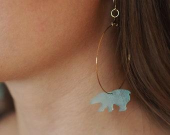 Creole earrings (large), polar bear, glacier blue version. Laser-engraved Plexiglas.