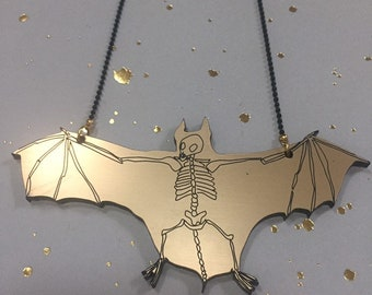 Bat necklace, gold version. Laser engraved smoked Plexiglas, ball chain. Cabinet of curiosities.
