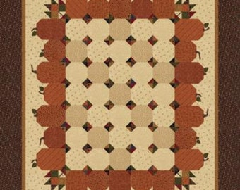 """Natures Glory Pumpkin Seeds Quilt Kit designed by Kansas Troubles Quilters for Moda Fabrics, 68"""" x 78"""" when finished"""