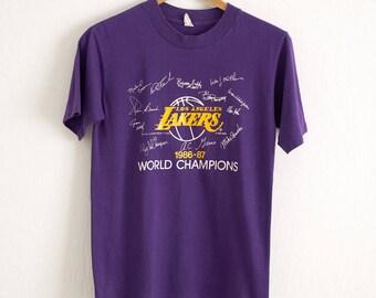 5994ba1cd VTG 1987 Los Angeles Lakers T Shirt Sz. M Medium Purple Tee NBA World  Champions LA Magic Johnson Kareem Abdul Jabbar Worthy LeBron James