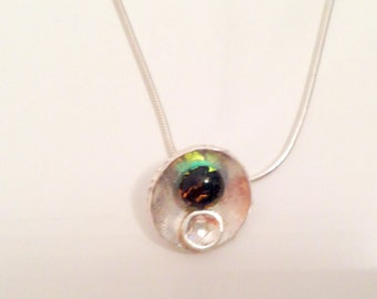 Beautiful sterling silver necklace with an unique silver/glass pendant.