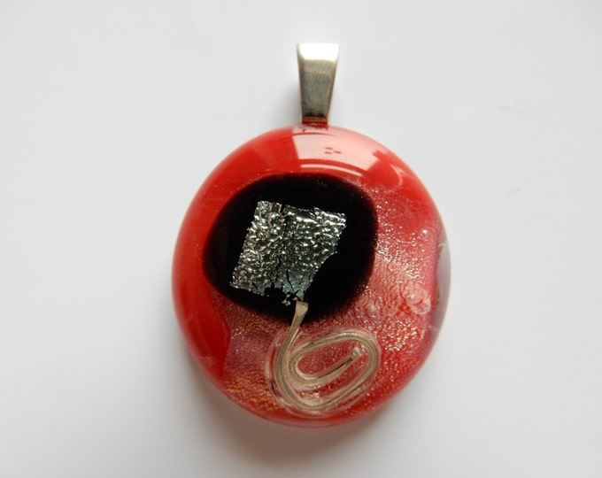 Glass pendant (Glasanhänger) with fused silver parts, sterling silver bail, black and red and clear glass