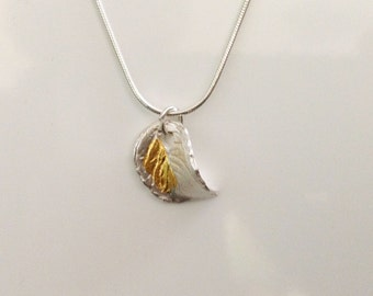 Fine silver leaf jewellery  with a natural look in a woven shape with fine gold  together with a sterling silver snake necklace