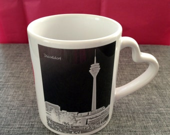 Decorative porcelain cup with a Pilbri ® Düssel Art Design print