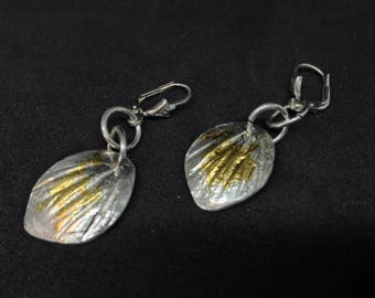 Earhangers with silver and finegold, sterling silver, 100 % finegold, very fashion in a leaf shape, silver leaf