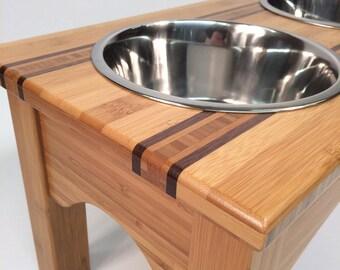 Bamboo raised feeder with walnut inlays