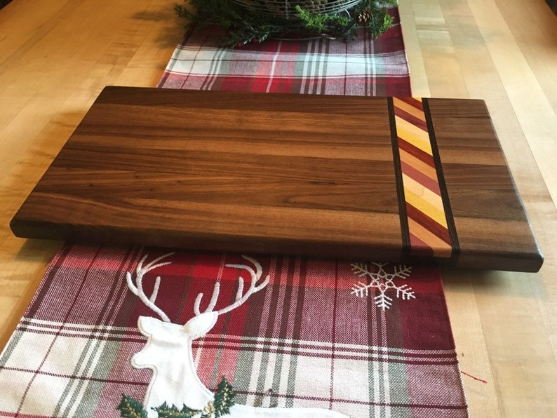 Walnut cutting board with exotic hardwood rainbow