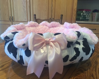 UDDER DELIGHT! :   Black and white cow pattern Velboa with baby pink Rosette Minky dog bed.