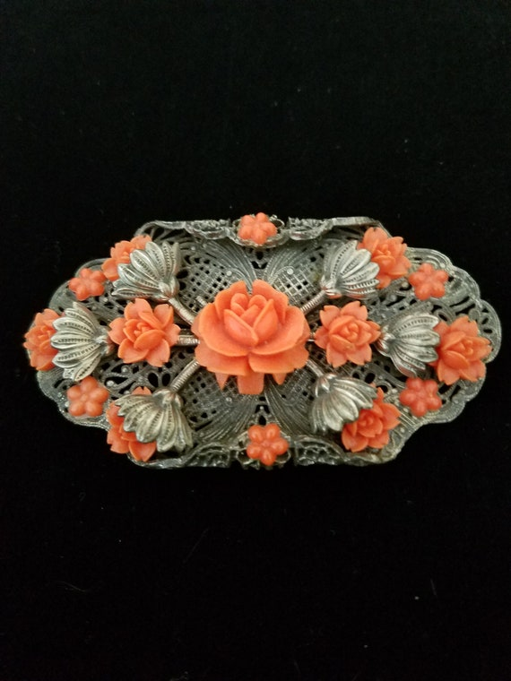 Coral Celluloid Brooch