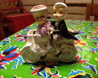 Vintage ceramic planter of older Gay 90s couple on a tandem bike- Enesco, Japan