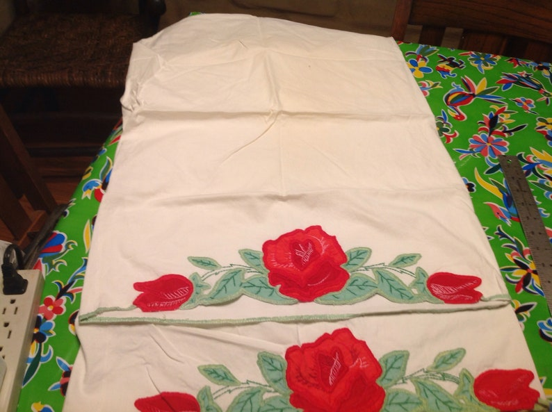 Vintage pair of embroidered pillowcases with rose designs