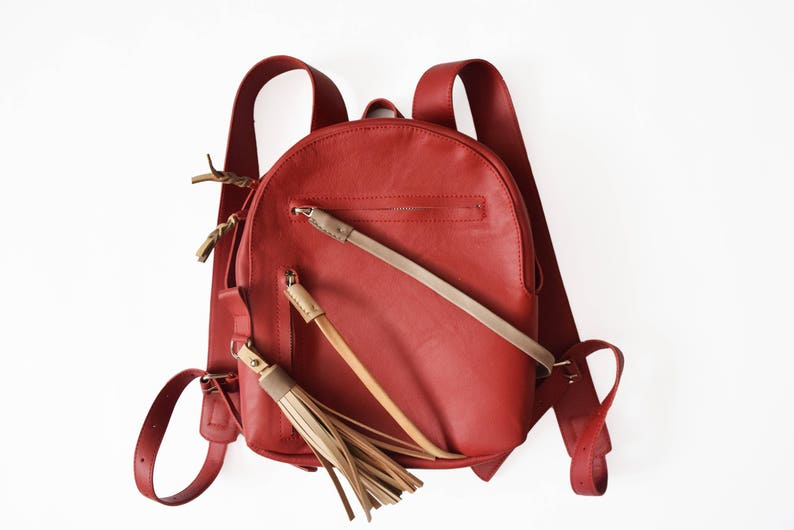 046465b8f3 Cute red leather zipped city backpack with a tassel